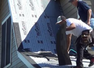 roofing experts replacing a roof